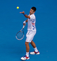 NOVAK DJOKOVIC (SRB) against NICOLAS MAHUT (FRA) in the third round of the Men's Singles. Novak Djokovic beat Nicolas Mahut 6-0 6-1 6-1..21/01/2012, 21st January 2012, 21.01.2012..The Australian Open, Melbourne Park, Melbourne,Victoria, Australia.@AMN IMAGES, Frey, Advantage Media Network, 30, Cleveland Street, London, W1T 4JD .Tel - +44 208 947 0100..email - mfrey@advantagemedianet.com..www.amnimages.photoshelter.com.