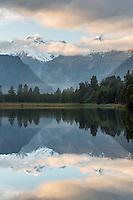 Lake Matheson with reflections of Mt. Cook and Mt. Tasman at sunrise, Westland National Park, West Coast, New Zealand