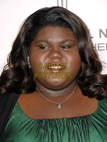 "GABOUREY ""GABBY"" SIDIBE.The Third Annual ESSENCE Black Women In Hollywood Luncheon held at The Beverly Hills Hotel in Beverly Hills, California, USA..March 4th, 2010                                                                    .headshot portrait black green .CAP/RKE/DVS.©DVS/RockinExposures/Capital Pictures."
