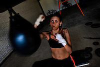 Geraldin Hamann, a young Colombian boxer, practices with speed bag in the boxing gym in Cali, Colombia, 26 June 2013. During the recent years, Kina Malpartida, a Peruvian female professional boxer, has won the World Championship title several times and so she has become a sporting idol and an inspiration for a generation of young girls throughout Latin America. Working out hard in poorly equipped gyms, they dream of becoming a boxing star. The Cauca Valley and the Caribbean coast are believed to be a home of the most talented female boxers in Colombia.