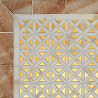 Joie, a waterjet mosaic shown in honed 24K Gold Glass, honed Honey Onyx and polished Calacatta, is part of the Aurora™ Collection by Sara Baldwin for New Ravenna.