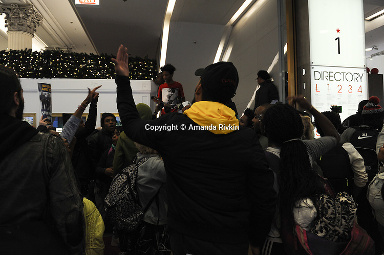 A small crowd of protesters calling on Chicago Mayor Rahm Emanuel to resign briefly entered Macy's in the Loop, Chicago, Illinois on December 9, 2015.  Emanuel offered a historic apology for the police killing of Laquan McDonald and police brutality and racial profiling generally -- without using those words -- in front of the City Council in the morning.