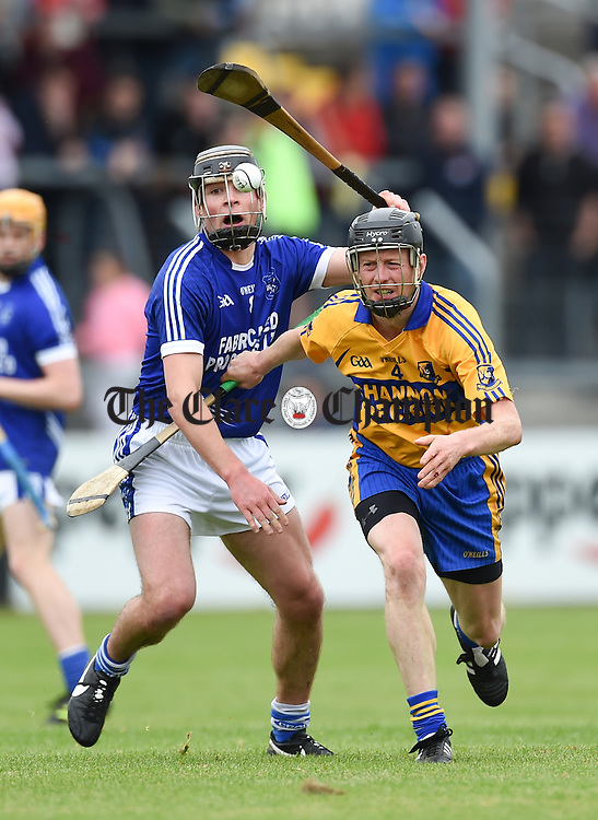 Tadgh Keogh of Sixmilebridge in action against Liam Markham of Cratloe during their game in Cusack Park. Photograph by John Kelly.