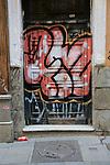 Graffiti spray painted on door, Malasana barrio, Madrid city centre, Spain