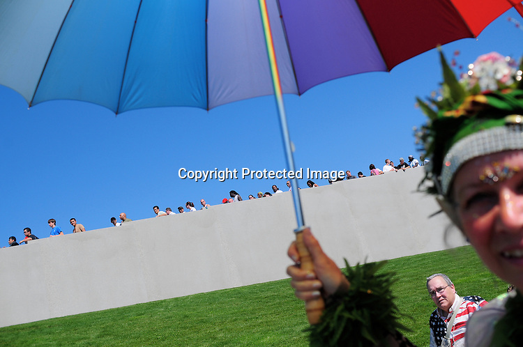 "Paka Lanalani keeps cool under a colorful umbrella while walking.through the entrance of Myrtle Edwards Park on the final day of.Hempfest August 16, 2009 in Seattle, WA. Festival organizers called the event ""the largest cannabis policy reform event in the world."" Tens of thousands attended the event over the weekend."