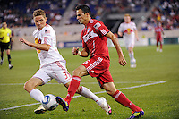 Marco Pappa (16) of the Chicago Fire is defended by Chris Albright (3) of the New York Red Bulls. The New York Red Bulls and the Chicago Fire played to a 2-2 tie during a Major League Soccer (MLS) match at Red Bull Arena in Harrison, NJ, on August 13, 2011.