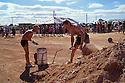 Men's dump-shoveling contest, during Opal Festival, Coober Pedy, South Australia
