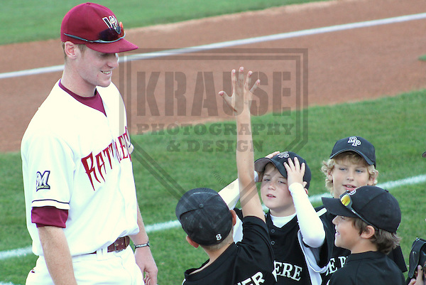 APPLETON - AUGUST 2011: Mike Walker (33) of the Wisconsin Timber Rattlers, Class-A affiliate of the Milwaukee Brewers talks with some little leaguers prior to a game on August 10, 2011 at Time Warner Cable Field at Fox Cities Stadium in Appleton, Wisconsin. (Photo by Brad Krause)