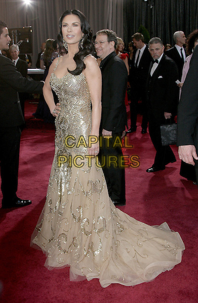 Catherine Zeta-Jones (wearing Zuhair Murad).85th Annual Academy Awards held at the Dolby Theatre at Hollywood & Highland Center, Hollywood, California, USA..February 24th, 2013.oscars full length silver gold beige tulle metallic dress hand on hip sequins sequined beads beaded .CAP/ADM.©AdMedia/Capital Pictures.