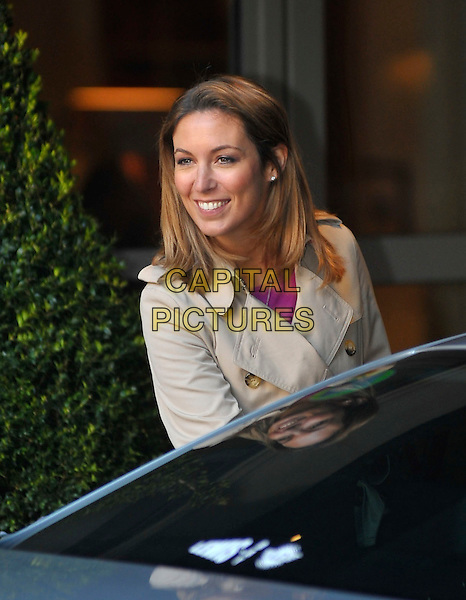 EMMA CROSBY.GMTV presenter spotted leaving a  London hotel, England, UK, .17th February 2010..portrait headshot smiling beige trench coat getting into car.CAP/DYL.©Dylan/Capital Pictures