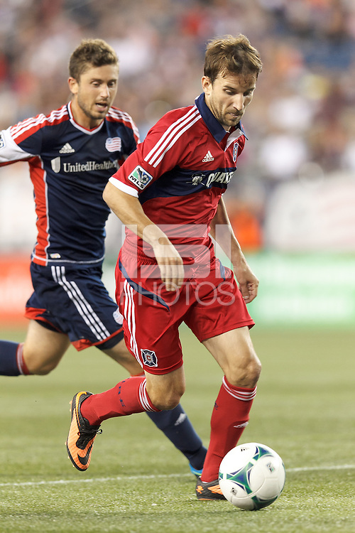 Chicago Fire forward Mike Magee (9) on the attack.  In a Major League Soccer (MLS) match, the New England Revolution (blue) defeated Chicago Fire (red), 2-0, at Gillette Stadium on August 17, 2013.