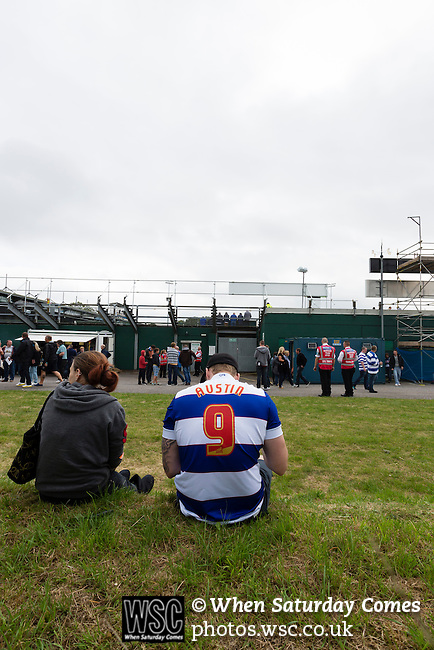 Yeovil Town 0 Queens Park Rangers 1, 21/09/2013. Huish Park, Championship. QPR fan wearing a No. 9 Austin shirt reading the match day programme. Photo by Paul Thompson.