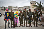 Israeli settlers take part in a parade to celebrate the Jewish holiday of Purim in al-Shuhada Street, in the West Bank town of Hebron, on March 12, 2017. The carnival-like Purim holiday is celebrated with parades and costume parties to commemorate the deliverance of the Jewish people from a plot to exterminate them in the ancient Persian Empire 2,500 years ago, as recorded in the Biblical Book of Esther. Photo by: JINIPIX