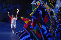 Aug. 8, 2008; Beijing, CHINA; China former gold medalist Zhang Jun runs with the Olympic torch during the opening ceremonies for the 2008 Beijing Olympic Games at the National Stadium. Mandatory Credit: Mark J. Rebilas-