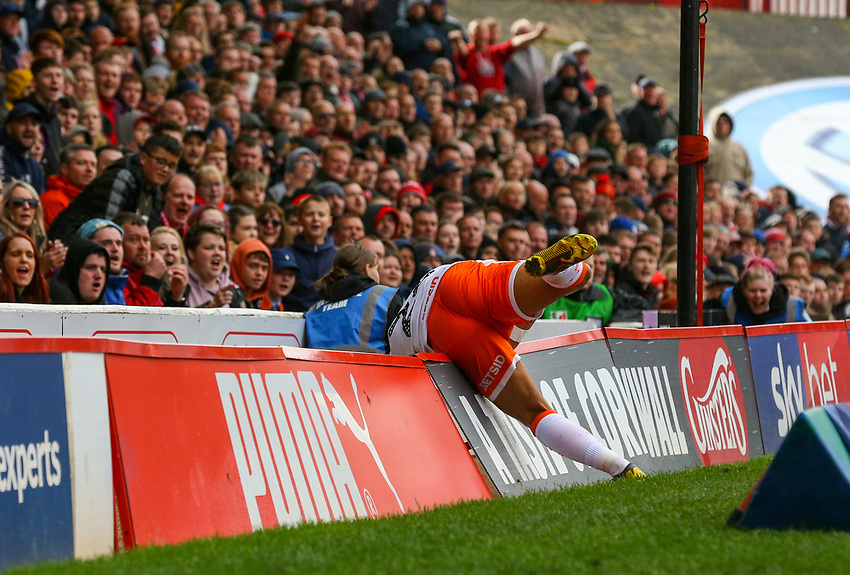 Blackpool's Liam Feeney falls over the advertising boards<br /> <br /> Photographer Alex Dodd/CameraSport<br /> <br /> The EFL Sky Bet League One - Barnsley v Blackpool - Saturday 27th April 2019 - Oakwell - Barnsley<br /> <br /> World Copyright © 2019 CameraSport. All rights reserved. 43 Linden Ave. Countesthorpe. Leicester. England. LE8 5PG - Tel: +44 (0) 116 277 4147 - admin@camerasport.com - www.camerasport.com