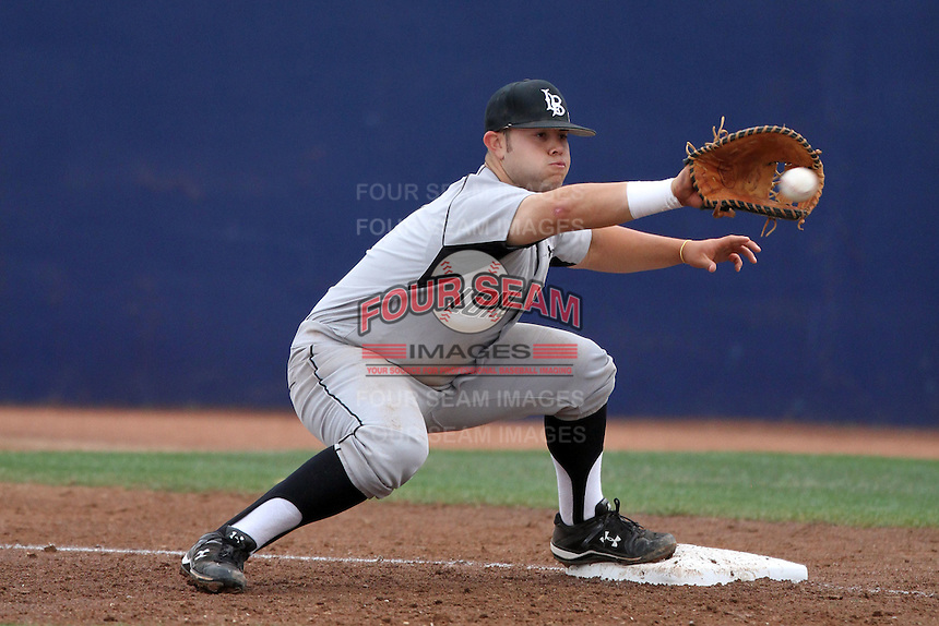 Ino Patron #4 of the Long Beach St. 49'ers catches a ball at first base against the Cal. St. Fullerton Titans at Goodwin Field in Fullerton,California on May 14, 2011. Photo by Larry Goren/Four Seam Images