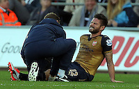 Olivier Giroud of Arsenal injured on the ground during the Barclays Premier League match between Swansea City and Arsenal at the Liberty Stadium, Swansea on October 31st 2015