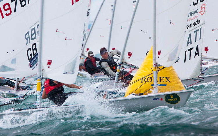 Laser fleet at the windward mark