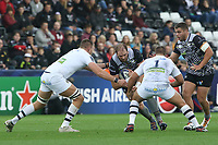 Alun Wyn Jones of Ospreys is tackled by Paul Jedrasiak and Raphael Chaume of Clermont during the Champions Cup Round 1 match between Ospreys and Clermont at The Liberty Stadium, Swansea, Wales, UK. Sunday 15 October 2017