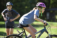 NWA Democrat-Gazette/DAVID GOTTSCHALK Instructor Cate Mertins watches Annie Meldrum, 14, move Monday, June 10, 2019, from the nuetral to ready position during the Mountain Bike Camp for Girls at the north shore of Lake Fayetteville. The week long camp for girls 8-11 years old is an introduction to mountain biking that includes learning basic trail skills riding, gaining confidence and developing a confident positive approach to cycling.