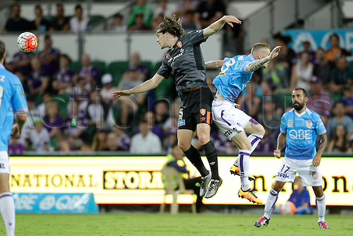 20.02.2016, Perth, Australia. Hyundai A-League, Perth Glory versus Brisbane Roar. James Donachie and Andrew Keogh compete for the header during the first half. Perth Glory defeated Brisbane Roar 6-3.
