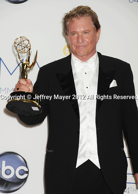 LOS ANGELES, CA - SEPTEMBER 23: Tom Berenger  poses in the press room at the 64th Primetime Emmy Awards held at Nokia Theatre L.A. Live on September 23, 2012 in Los Angeles, California.