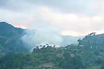 Rising smoke of Slash & Burn practice to clear forest for farming, Ranomafana National Park, Madagascar