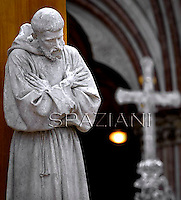 St Francis statue.Pope Francis  leads a mass outside the St Francis Basilica as part of his pastoral visit in Assisi on October 4, 2013.