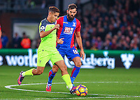 Philippe Coutinho of Liverpool carries the ball past Joe Ledley of Crystal Palace during the EPL - Premier League match between Crystal Palace and Liverpool at Selhurst Park, London, England on 29 October 2016. Photo by Steve McCarthy.