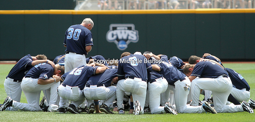 North Carolina Head Coach Mike Fox (30) gathers with his team before an elimination game against Texas. UNC's 3-0 win eliminated Texas from the 2011 College World Series in Omaha, Neb. (Photo by Michelle Bishop)..