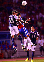 SAN JOSE, COSTA RICA - September 06, 2013: Jermaine Jones (13) of the USA MNT heads over Celso Boges (5) of the Costa Rica MNT during a 2014 World Cup qualifying match at the National Stadium in San Jose on September 6. USA lost 3-1.
