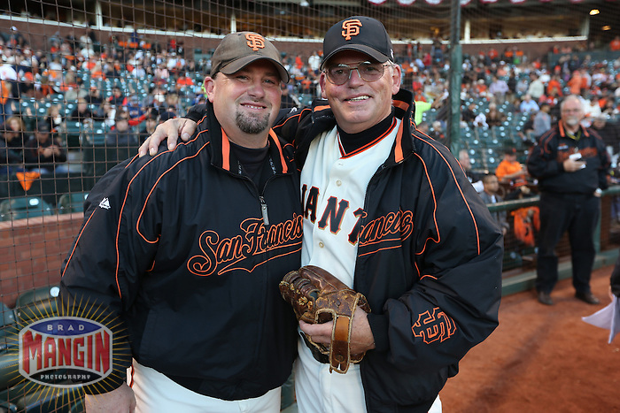 SAN FRANCISCO - OCTOBER 6:  Ball dudes Clyde Fralick and Frano Falick of the San Francisco Giants pose for a picture before Game 1 of the NLDS against the Cincinnati Reds at AT&T Park on October 6, 2012 in San Francisco, California. (Photo by Brad Mangin)