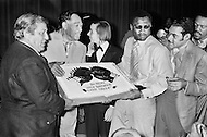 March 8th, 1971. Manhattan, New York City, New York State, USA. Boxer Joe Frazier and Musician Duke Ellington hold the victory cake after Joe Frazier defeated Muhammad Ali for the World Heavyweight Championship at Madison Square Garden.