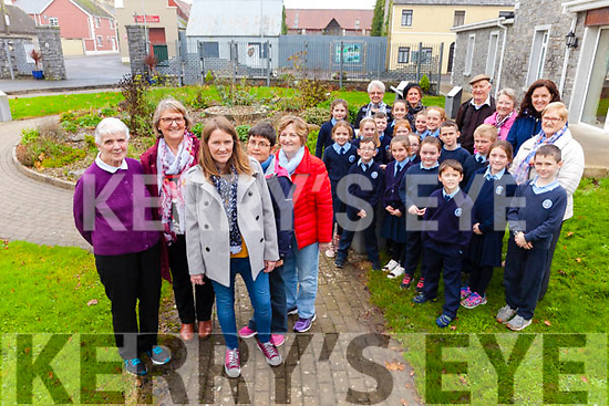 Rural Ballylongford and how it has changed will the the focus of a documentary on TG4 next year. Pictured were: Medb Johnstone (producer Midas Productions) with Kitty McElligott, Phil Walsh, Helen Lane and Noirín Lynch and children from St Oliver's NS.