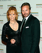 Washington, D.C. - December 2, 2006 -- Reba McEntire and husband, Narvel Blackstock arrive for the State Department Dinner for the 29th Kennedy Center Honors dinner at the Department of State in Washington, D.C. on Saturday evening, December 2, 2006.  Andrew Lloyd Webber, Zubin Mehta, Dolly Parton, Smokey Robinson and Stephen Spielberg are being honored in 2006 for their contribution to American culture..Credit: Ron Sachs / CNP