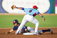 Jose Peraza (7) of the Mississippi Braves steals second base ahead of the tag from Tennessee Smokies shortstop Addison Russell (4) at Smokies Park on July 22, 2014 in Kodak, Tennessee.  The Smokies defeated the Braves 8-7 in 10 innings. (Brian Westerholt/Four Seam Images)