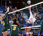 BROOKINGS, SD - SEPTEMBER 30:  Hadley Steffen #10 from North Dakota State defends as Wagner Larson #11 from South Dakota State tips the ball over the net in the first game of their match Tuesday night at Frost Arena in Brookings. (Photo/Dave Eggen/Inertia)