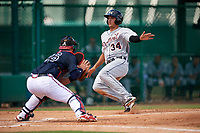 Detroit Tigers Danny Pinero (34) slides home as catcher Abrahan Gutierrez (46) looks to apply the tag during an Instructional League game against the Atlanta Braves on October 10, 2017 at the ESPN Wide World of Sports Complex in Orlando, Florida.  (Mike Janes/Four Seam Images)
