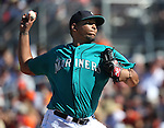 Seattle Mariners' Mayckol Guaipe pitches against the SF Giants in a spring training game in Peoria, Ariz., on Wednesday, March 16, 2016. <br />