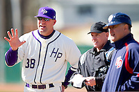 High Point Panthers head coach Craig Cozart #38 goes over the ground rules with Dayton Flyers head coach Tony Vittorio and home plate umpire Randy Collins prior to the start of the game at Willard Stadium on February 26, 2012 in High Point, North Carolina.    (Brian Westerholt / Four Seam Images)