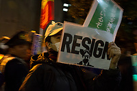 "A man holds a sign saying ""Resign"" as hundreds of students and other activists protest outside the Japanese prime Minister's office calling on the Japanese Prime Minister, Shinzo Abe and Finance Minister, Taro Aso to resign over a suspected cover-up of the Moritomo Gakuen school  land sale scandal and falsified documents. Kasumigaseki, Tokyo, Japan Friday, March 23rd 2018"