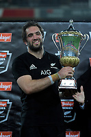 NZ's Sam Whitelock with the series trophy after the Steinlager Series international rugby match between the New Zealand All Blacks and France at Westpac Stadium in Wellington, New Zealand on Saturday, 16 June 2018. Photo: Dave Lintott / lintottphoto.co.nz