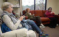Eunice Millet (from left), Ruth Rodgers, Janet Clausen and Melinda Elgin (not pictured) knit and crochet Friday, Jan. 10, 2020, during a meeting of the Hooks and Needles group at First United Presbyterian Church in Fayetteville. The group meets at 10 a.m. on Fridays and makes items for a yearly holiday sale. Check out nwaonline.com/200111Daily/ for today's photo gallery.<br /> (NWA Democrat-Gazette/Andy Shupe)