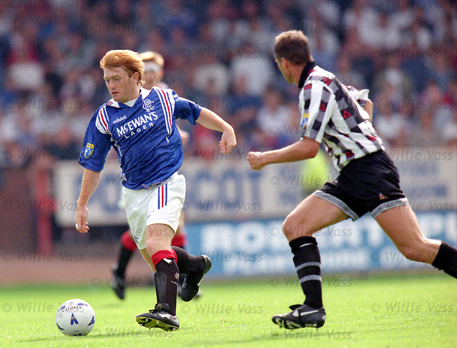 Stuart McCall breaks through the Dunfermline midfield
