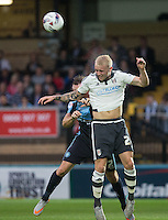 Jack Grimmer of Fulham wins the ball in the air during the Capital One Cup match between Wycombe Wanderers and Fulham at Adams Park, High Wycombe, England on 11 August 2015. Photo by Andy Rowland.