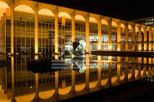 Brasilia, DF, Brazil. Palácio do Itamaraty (Ministry of Foreign Relations, Itamaraty Palace) at night with reflection in water. Architect Oscar Niemeyer.