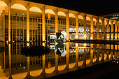 Brasilia, DF, Brazil. Palácio do Itamaraty (Ministry of Foreign Relations, Itamaraty Palace) at night with reflection in water. Architect Oscar Niemeyer.