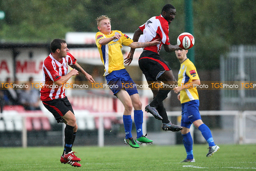 Tambeson Eyong of Hornchurch rises with Teddy Nesbitt of Concord - AFC Hornchurch vs Concord Rangers - FA Cup 1st Qualifying Round Football at The Stadium - 17/09/11 - MANDATORY CREDIT: Gavin Ellis/TGSPHOTO - Self billing applies where appropriate - 0845 094 6026 - contact@tgsphoto.co.uk - NO UNPAID USE.