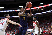 RALEIGH, NC - JANUARY 9: Juwan Durham #11 of the University of Notre Dame shoots a layup during a game between Notre Dame and NC State at PNC Arena on January 9, 2020 in Raleigh, North Carolina.