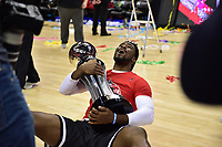 Washington, DC - MAR 11, 2018: Davidson Wildcats forward Nathan Ekwu (1) celebrates with the trophy after winning the Atlantic 10 men's basketball championship between Davidson and Rhode Island at the Capital One Arena in Washington, DC. (Photo by Phil Peters/Media Images International)